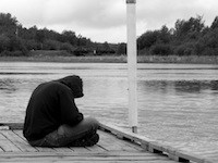 Depressed Person on the Dock